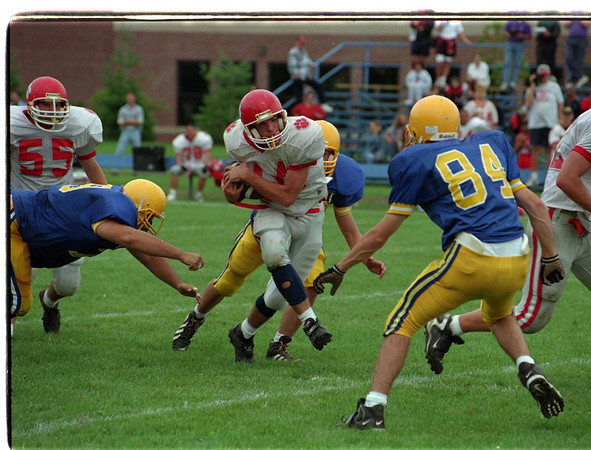 97/09/13 NF vs Lockport 2 - James Neiss Photo - #14 Thomas Kresman of Niagara Falls tries to avoid  the rush durring the 2nd qtr against Lockport.