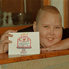 98/12/02 Cancer Card - James Neiss Photo - Tom Stevens of Wheatfield, a young cancer victom, shows off a Roswell Center birthday card featuring his artwork.