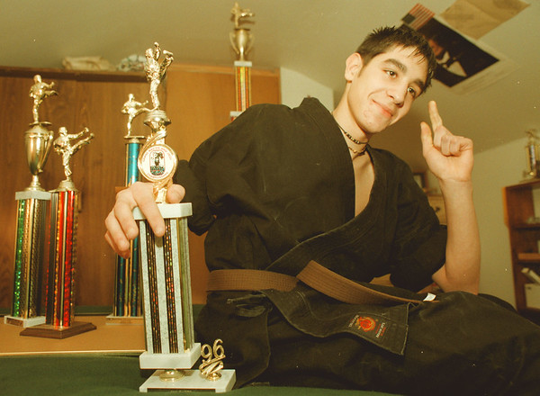 98/01/17-- Dominic LoTempio--Takaaki Iwabu photo-- Dominic LoTempio shows off the trophies he won at the karate tournaments. A 14-year-old boy, who has juvenile arthritis and lupus, keeps himself in active to fight with his decease. <br /> <br /> local, bw, Sunday  --with promo