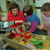 98/02/05 Macaroni Bin *Dennis Stierer photo - Foster grandma, Jeanne Schultz plays with from left  Seth Wingrove, Katrina Stinglin, and Cherylynne Harris at the macaroni bin with the Headstart program.