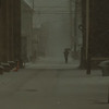 97/12/10  Weather 2 - James Neiss Photo - A lone man walks in the inclement weather on Walnut near 10th.