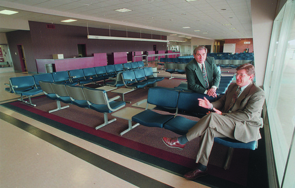 3/18/97 Niagara Falls Airport - James Neiss Photo - Town of Niagara Econimic Development projects office Director Nicholas A. Curtis and Niagara Frontier Transportation Authority Airport Manager Ralph E. Napolitano in the newly remodled terminal area at the airport.