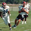 7/11/97- bills camp 1--Takaaki Iwabu photo-- 1997 draft No1 pick Antowain Smith practices the combination with QB Todd Collins at the Bills training camp in Fredonia. <br /> <br /> sports, Sunday, color