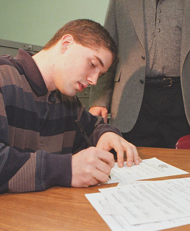 2/5/97--SCHMIDLE/WISLON FOOTBALL--DAN CAPPELLAZZO PHOTO--WILSON HIGH FOOTBALL STAR DAVE SCHMIDLE SIGNS A LETTER OF INTENT TO PLAY AT UB.