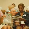 7/14/97 HANCI - James Neiss Photo - Gordon Paul of NF listens as HANCI Senior Companion Margie Caffey reads to him.