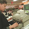 "98/01/15--SALES TAX--DAN CAPPELLAZZO PHOTO--""DEB"" STORE MANAGER PAULETTE HANDY CHECKS THE REGISTER AT THE RAINBOW OUTLET STORE AAS SHE PREPARES FOR TAX FREE SAHOPPING TO COME.<br /> <br /> 1A"
