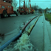 98/01/09--CAYUGA/THE DAY AFTER--DAN CAPPELLAZZO PHOTO--NI MO CREWS WORK TO RESTORE POWER AS PUMPS WORK OVERTIME TO DRY CAYUGA PK STREETS.<br /> <br /> 1A