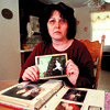2/17/97--BOAT MURDER KYLER--DAN CAPPELLAZZO PHOTO--ROSANNA KYLER, OF N.F., HOLDS UP A PHOTO OF HER SON GAYTANO (AND HIS FIANCE) AS SHE LOOKS THROUGH A SCRAP BOOK SHE HAS KEPT SINCE HER SON WAS KILLED NBY A BOATER IN THE NIAGARA RIVER.<br /> <br /> 1A