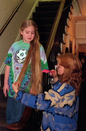 98/02/21 Long, Long Hair *Dennis Stierer photo - Barbara Speer helps comb out the tangles in Ashley's hair,  her daughter. Ashley won the 6-12 year old class with a length of 42 inches. They are from Lockport. This was the long hair contest held at the Niagara County Historical Society.