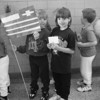 "1/28/97-- catholic week 1-- Takaaki Iwabu photo-- Nicole Carr holds the flag of Greece as she and other students line up for the ""parade of diveity"" at Stendents of St. Joseph School Tuesday. The School celebrates its annual Catholic Schools Week with various events. Next to Carr is Caitlin Xenopoulos. <br /> <br /> grapevine photo"