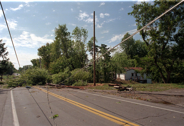 98/09/07 Road Closed *Dennis Stierer Photo -<br /> Lockport-Olcott Rd., Rt78 in Burt was closed Sunday due a massive set of trees down that took several power and telephone lines down.