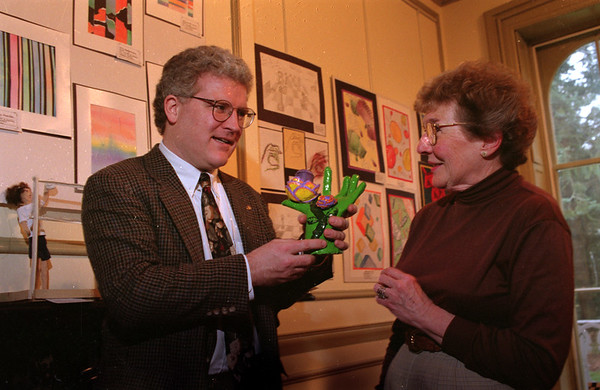 98/01/06 Kenan Student Art*Dennis Stierer photo - Tom Honan, Executive Director of the Kenan House and Louah Lewis, Show Chairperson of the student art show look over a clay sculpture by Allison Beatty, 8th grader from Emmet Belknap school.