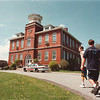 5/13/97--brick buldg, L--Takaaki Iwabu photo-- Red Brick School in Lewiston. Area teens walk toward the basketball court behind the building. <br /> <br /> tmc photo
