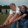 98/06/05 Lyndon Tugs-Rachel Naber Photo- Lyndonville celebrated the closing of the school year with it's 20th annual class day. Maegan Neal (left), Melissa Gray (right) fall to defeat in the tug of war against classmates.
