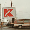 "98/03/02--OUT WITH THE OLD--DAN CAPPELLAZZO PHOTO--WORKERS FROM WILCOX BROS. SIGNS, TONAWANDA, TAKE DOWN THE OLD KMART SIGH AT THE MILITARY RD STORE. A NEW SIGH WILL GO UP IN A FEW WEEKS WITH THE NEW STORE NAME ""BIG KMART.""<br /> <br /> GRAPE"