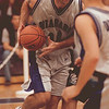 98/12/04 nu hoops b&W--dan cappellazzo photo-- nu  forward mike piwerka drives for the basket.<br /> <br /> sp