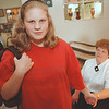 5/1/97--SUN TOPIC/TEEN FREEDOM--DAN CAPPELLAZZO PHOTO--14-YR-OLD CHRISTINE FERRANTE STNDS WITH SCHOOL BACKPACK IN HAND AS MOTHER BETTY TACZAK HOLDS HER DAUGHTERS' HAND AT THEIR  38TH STREET HOME.<br /> **EDS NOTE: TO GO WITH STORY ON TEEN FREEDOM**<br /> <br /> SUNDAY 1A