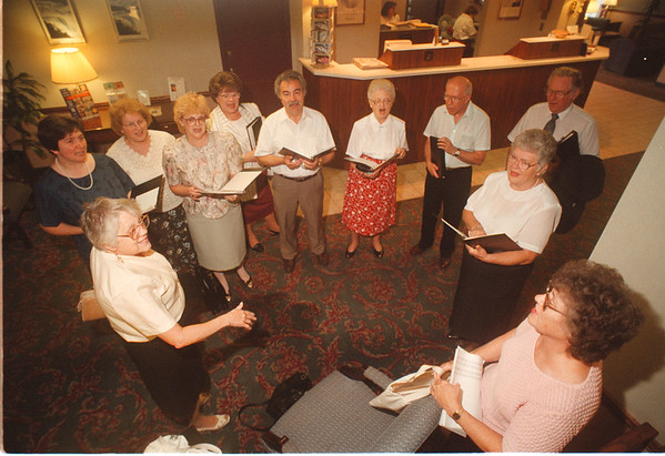 97/09/11 Senior Companion - James Neiss Photo - The Rainbow Singers mixed choral Group, from the music school of Niagara,  practice before singing at the Senior Companion Program Luncheon at the Best Western Hotel.