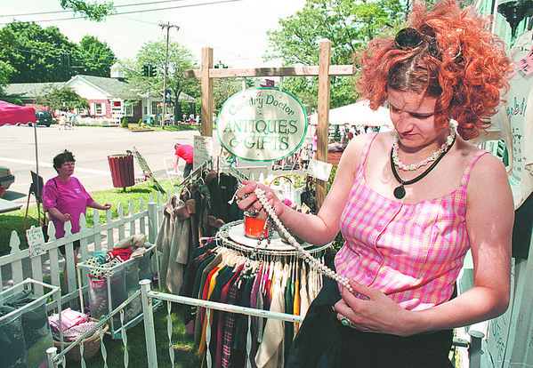 6/23/97--LEWISTON FAIR--DAN CAPPELLAZZO PHOTO--DANA CALANAN,  VINTAGE CLOTHING DEAL INVOLVED WITH THE COUNTY DOCTOR/LEWISTON TRADING POST CO-OP, LOOKS OVER SOME VINTAGE JEWELRY AT THE LEWSITON CRAFT FAIR.
