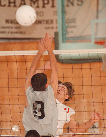 9/16/97--V-BALL/LASALLE/NF--DAN CAPPELLAZZO PHOTO--NF'S DAN HARSHMAN (FACING CAMERA) GOES UP FOR THE SPIKE AS LASALLE'S TONY PERNO TRIES FOR THE BLOCK IN HIGH SCHOOL V-BALL ACTION AT LASALLE HIGH.<br /> <br /> SPORTS