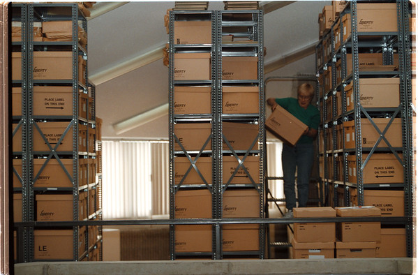 98/11/03 Archive boxes - Vino Wong Photo - Sherry Shepherd-Corulli removes boxes of archives material at the public library Wednesday afternoon. Corulli says these archives dates back to 1852 and some of the recent materials are being process on micro film.