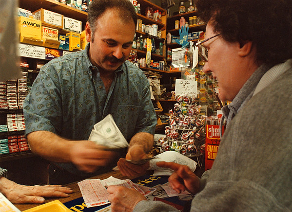 5/30/97-- ny lotto--Takaaki Iwabu Photo-- Gary Fryza, owner of Ted Mars on 3529 Packard Rd, was busy Friday with customers who bought New York Lotto which is hitting  $70 million this weekend.
