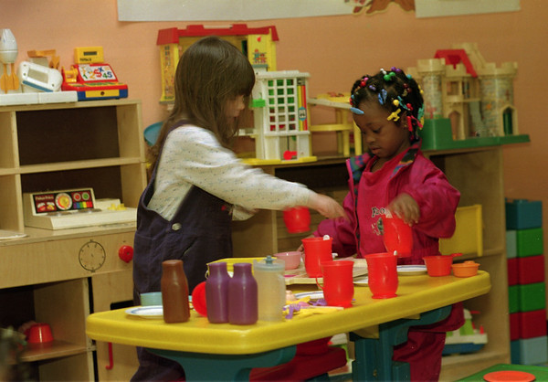 98/02/18 Playtime * Dennis Stierer photo - The best time during daycare is playtime as Carissa Townsend, 4 and Chelsyea Herring, 4 set the table for a little afternoon tea. The photo was taken at