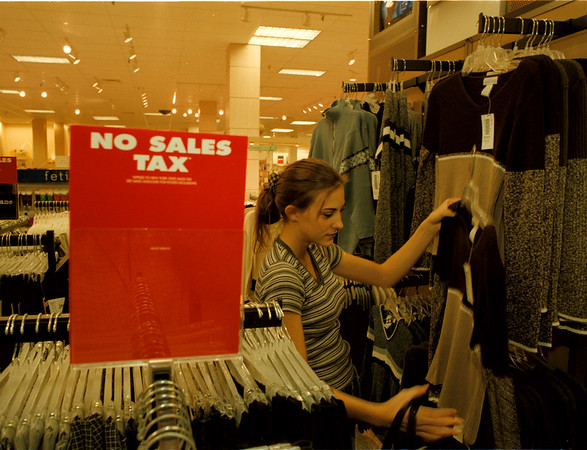 98/09/07 NO SALES TAX - James Neiss photo - Leah Curione of Sanborn shops for school cloths at Sears in the Summit Park Mall. Today was the last day of sales tax amnesty.