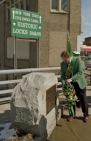 98/03/17 Placing Wreath *Dennis Stierer photo - Joe Castle with AOH places a wreath at the Irish monument downtown Lockport on the big bridge.