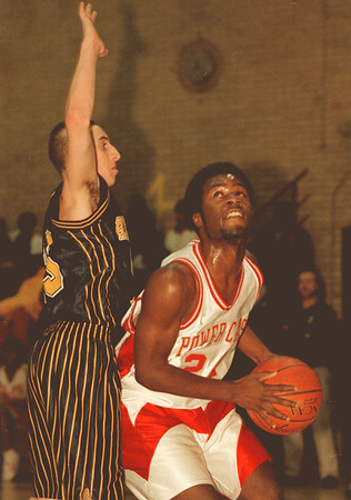 98/01/13-- HS basket, bw--Takaaki Iwabu photo-- Cozell Ferrell of Niagara Falls, right, looks up the basket against Kenmore East defender.