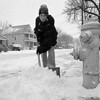 1/13/97--SHOVELING--CAPPY PHOTO--11-YR-OLD DANIEL HOMISZCZAK, OF NIAGARA STREET, SHOVELS THE SNOW FROM THE CORNER IN FRONT OF HIS HOME.<br /> <br /> GRAPEVINE