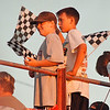 97/08/05 Speedway--Takaaki Iwabu photo-- Todd McNulty, 13, left, and James Friesen, 12, wave checker flags as they watch the race at Ransomville Speedway Tuesday. <br /> <br /> sports, Wednesday, color