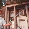 7/15/97-- water spray--Takaaki Iwabu photo-- Thad Raczkowski, member of First Unitarian Universalist Church, sprays water on the Church's garden on Main Street Tuesday. He volunteers his time taking care of the garden. <br /> <br /> grapevine photo