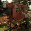 98/09/04--STAGE COACH--DAN CAPPELLAZZO PHOTO--88-YR-OLD EDWIN FEDESON, PORTLAND STREET, POSES WITH THE 1866 STAGE COACH HE RESTORED. IT TOOK HIM 4 MONTHS TO COMPLETE THE JOB.<br /> <br /> WED LIVING