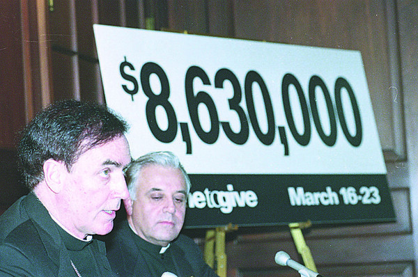 1/9/97 Charities Goal - James Neiss Photo - L-R - James V. Glynn, 1997 Appeal General Chairman (Not Shown),  Bishop Henry J. Mansell and Monsignor Henry J. Gugino, Diocesan director of Catholic Charities, announce the finantial goal for this drive.