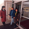 2/11/97 Casino Niagara - James Neiss Photo - Door Attendent Rito Vetrone holds the door for Toronto Residence Omar Sanchez and girlfriend Claudia Ruiz who came up just for the day.