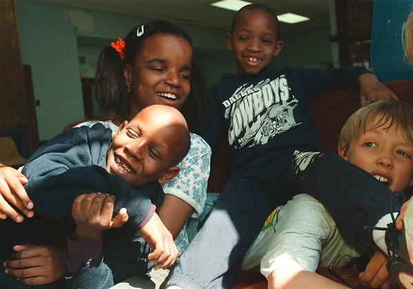 5/15/97-- YMCA/award--Takaaki Iwabu photo-- Brittany Acoff, above left, plays with her friend (Edward Pratt, Sidney Pratt and Justin Riley) at YMCA on Portage Road. Acoff, a 10-year-old girl from Niagara Falls, is one of the YMCA members who will receive Youth of the Year Award. <br /> <br /> local, Saturday