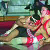 1/13/97--COLOR WRESTLING--CAPPY PHOTO--NF'S TOM WESTON (TOP) TIES UP NW'S MOHAMMED DUBASHI IN THE 140LBS WIEGHT CLASS. DUBASHI WON THE MATCH.<br /> <br /> SP