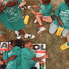 8/1/97 run from drug 2--Takaaki Iwabu Photo --Amanda Knighton, 4, and Quin Taylor, 3, takes a nap after they run with other participants for the 8th Annual Run From Drug race Friday on Centre Ave. <br /> <br /> grapevine photo