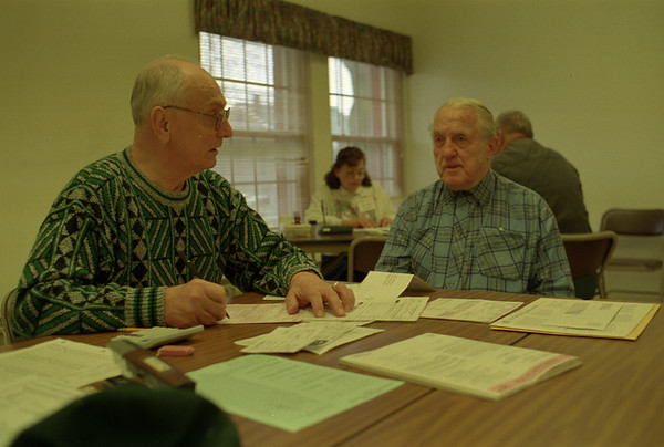 98/02/18 Tax Help * Dennis Stierer photo - AARP Tax-Aide Volunteer Ray Dreher helps Frank Hartfiel with his taxes at the senior center. This assistance is provided free of charge.