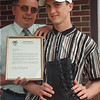 6/18/97--William Farnham--Takaaki Iwabu photo-- Bill Farmham III, right, is the second Tuscarora Indian to be accepted into West Point (United States Military Academy). The first was his uncle. Holding the admission certificate is his father, Bill Farnham Jr. <br /> <br /> local, Thursday