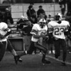 98/09/05 Medina Football #2  *Dennis Stierer Photo -<br /> Medina's  quarterback #9 gets some blocking from #31 as running back #23 helps the quarterback look for his mark to throw.