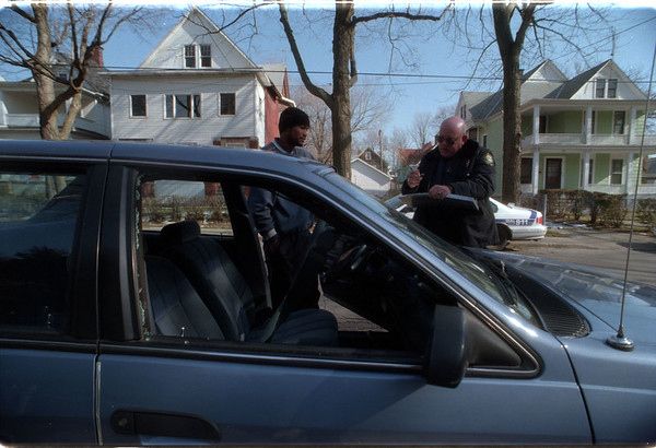 98/02/10 Shot out Window - James Neiss Photo -  NF police officer James Tarapczynski takes a report from Shawn Rose of Ransomville who had his car window shot out on 10th street.