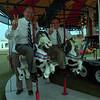 98/08/07 D'Amato Fair 2 - James Neiss Photo - Sen. Al D'Amato and George Maziarz ride the merry-go-round at the Niagara County Fair.
