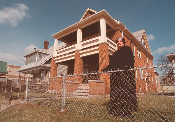 3/18/97 City Taxes - James Neiss Photo - Sandra Hayes, Chairman of the small business council and exiecutive dir of the pine ave. small business association stands infron of 1234 and 1244 pine. 1244 pine was once taxed apx 2 thousand higher because of the two tier system.