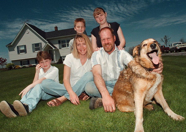 5/24/97-- foster parents-- Takaaki Iwabu photo --Liz and Todd Tower sit with their foster children , from left, Autumn Jordan, 9, Derek Jordan, 10, and Nicole Prickett, 15. in front of their house in Cambria. (Dog is Stubby.) Liz and Todd were chosen as the foster parents of the year by Niagara County's Department of Social Service. <br /> <br /> Sunday, local, color