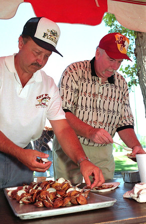 98/07/29Great Steamers *Dennis Stierer Photo -<br /> Doug Dempsey and Dave Wilson enjoy some fresh hot steamers at the Hickory Club outing held at the Niagara County Country Club.