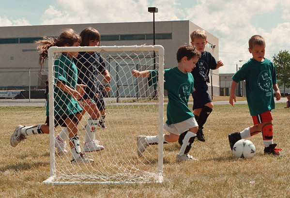 7/27/97--SOCCER 4--DAN CAPPELLAZZO PHOTO--TEAM JAMACIA, GREEN, CLEARS THE BALL FORM IN FRONT OF THEIR OWN GOAL AS TEAM  CANADA PRESSES AT LASALLE HIGH.<br /> <br /> FEATURE