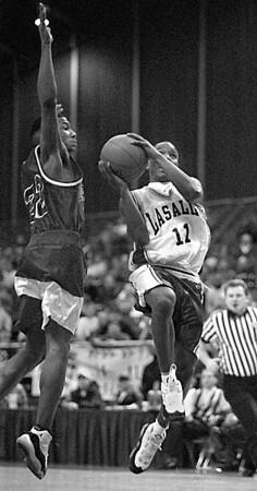 2/28/96--LaSalle basket 2--tak photo--Tim Winn goes up for layup beating Jamestown's Blake Johnson.