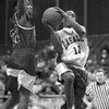 2/28/96--LaSalle basket 2--tak photo--Tim Winn goes up for layup beating Jamestown's Blake Johnson.